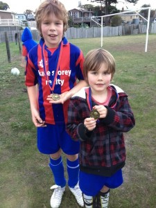 Liam and Caleb Walker with their replacement medallions June 2013